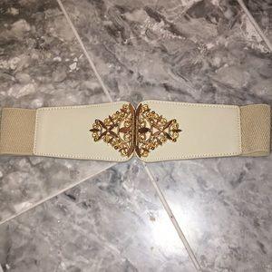 beige elastic waist belt with gold hardware